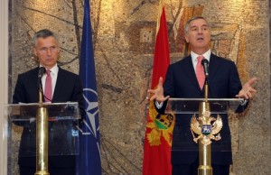 Montenegro's Prime Minister Milo Djukanovic, right, speaks and gestures after talks with NATO Secretary-General Jens Stoltenberg, in Podgorica, Montenegro, Thursday, June 11, 2015. Montenegro will have to beef up its public support for NATO and strengthen the rule of law before it can become a member, the alliance's secretary-general said Thursday. (AP Photo/Risto Bozovic)