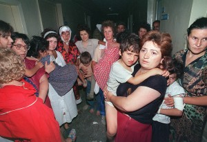 A group of women with their children remain in the corridors of the Budennovsk hospital 18 June 1995 during the spectacular and bloody hostage-taking by Chechen war lord Shamil Basayev in the southern town of Budennovsk. The hostage-taking which killed nearly 150 people in a Budennovsk hospital in June 1995 forced Moscow to start talks in the first conflict in Chechnya. Just before the collapse of the Soviet Union in 1991, Chechnya proclaimed independence and in 1992 separated from Ingushetia. The then Russian president Boris Yeltsin launched a military intervention in Chechnya in December 1994 which ended in 1996 with an accord that failed to address the region's final status. A new conflict erupted in October 1999 and has since left at least 4,500 Russian soldiers dead, according to official figures although other groups say the true number is closer to 13,000. There are in some 70,000 Russian soldiers based in the republic, while Moscow estimates the rebel forces at around 1,500 to 5,000. AFP PHOTO VLADIMIR MASHATIN