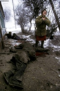 A woman grieves for ethnic Russian friends and neighbours who were mowed down by artillery attack. They had been standing in line at what they had heard was a distribution point for bread. Many Russian residents of Grozny had no relatives in rural Chechnya where they could take refuge during the bombing.