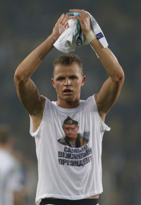 "Locomotiv Moscow's Dmitri Tarasov features an inner shirt with a picture of Russian President Vladimir Putin and the slogan ""The most polite President"",  following a Europa League first leg round of 32, soccer match against Fenerbahce in Istanbul, Tuesday, Feb. 16, 2016. Fenerbahce won the match 2-0. (AP Photo/Emrah Gurel)"