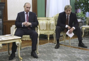 Russian Prime Minister Vladimir Putin, left, and  his spokesman Dmitry Peskov, seen during a teleconference with Turkish Prime Minister Recep Tayyip Erdogan while meeting  Italian Prime Minister Silvio Berlusconi, unseen in the photo, to discuss energy in St. Petersburg, Russia, Thursday, Oct. 22, 2009. Berlusconi has arrived in Russia for two days of talks with Putin. (AP Photo/RIA-Novosti, Alexei Nikolsky, Pool)