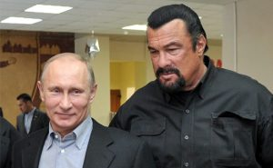 (FILES) This photo taken on March 13, 2013 shows Russia's President Vladimir Putin and American action movie actor Steven Seagal visiting a newly-built sports complex of Sambo-70 prominent wrestling school in Moscow. Hollywood tough guy Steven Seagal has had his blues gig cancelled at a festival in Estonia following an uproar in this formerly-Soviet ruled Baltic state over the star's pro-Russia views, the authorities said on July 29, 2014. AFP PHOTO/ RIA-NOVOSTI/ POOL / ALEXEI NIKOLSKY / AFP PHOTO / ALEXEI NIKOLSKY