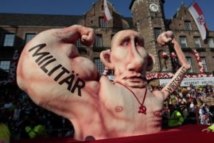 A carnival float with a paper-mache caricature of Russia's President Vladimir Putin drives past revellers during the traditional Rose Monday carnival parade in the western German city of Duesseldorf February 16, 2015. The Rose Monday parades in Cologne, Mainz and Duesseldorf are the highlight of the German street carnival season. REUTERS/Ina Fassbender (GERMANY - Tags: POLITICS SOCIETY) - RTR4PSYK