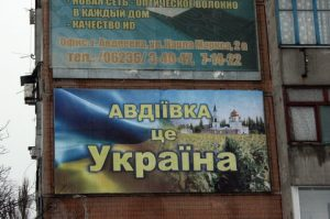 A poster hangs that reads ' Avdiivka belongs to Ukraine' in Avdiivka, Ukraine 28 January 206. The small town is located at the front of the separatists and reconstruction is progressing slowly. Photo: Friedemann Kohler/dpa