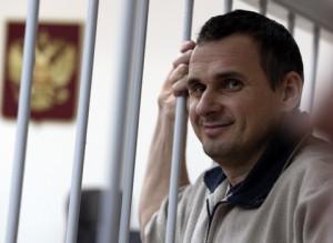 MOSCOW, RUSSIA. DECEMBER 26, 2014. Ukrainian film director Oleg Sentsov (L), detained in Crimea on charges of terrorism, seen in a cage during a hearing into the investigator's request to extend his arrest at Moscow's Lefortovo District Court. Mikhail Pochuyev/TASS  Ðîññèÿ. Ìîñêâà. 26 äåêàáðÿ. Óêðàèíñêèé ðåæèññåð Îëåã Ñåíöîâ, çàäåðæàííûé â Êðûìó ïî ïîäîçðåíèþ â ïîäãîòîâêå òåðàêòîâ, âî âðåìÿ ðàññìîòðåíèÿ âîïðîñà î ïðîäëåíèè àðåñòà â Ëåôîðòîâñêîì ðàéîííîì ñóäå. Ìèõàèë Ïî÷óåâ/ÒÀÑÑ