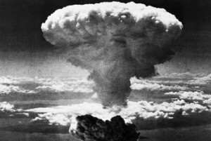 FILE - In this Aug. 9, 1945 file photo, a mushroom cloud rises moments after the atomic bomb was dropped on Nagasaki, southern Japan. On two days in August 1945, U.S. planes dropped two atomic bombs, one on Hiroshima, one on Nagasaki, the first and only time nuclear weapons have been used. Their destructive power was unprecedented, incinerating buildings and people, and leaving lifelong scars on survivors, not just physical but also psychological, and on the cities themselves. Days later, World War II was over. (AP Photo/File)