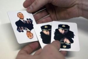 """MOSCOW, RUSSIA. DECEMBER 9, 2014. A man holds playing cards with images of U.S. president Barack Obama and Russian president Vladimir Putin at the """"Heroes of Our Time"""" youth convention held as part of Heroes' Day celebrations. The convention is designed for active young people interested in politics, culture, business, sports, etc. Zurab Dzhavakhadze/TASS Ðîññèÿ. Ìîñêâà. 9 äåêàáðÿ. Íà ìîëîäåæíîì êîíâåíòå """"Ãåðîè íàøåãî âðåìåíè"""" â ðàìêàõ Äíÿ Ãåðîåâ Îòå÷åñòâà. Êîíâåíò ïðîõîäèò äëÿ ïðåäñòàâèòåëåé àêòèâíîé ìîëîäåæè, êîòîðûå èíòåðåñóþòñÿ ïîëèòèêîé, êóëüòóðîé, áèçíåñîì, ñïîðòîì è äðóãèìè ñôåðàìè îáùåñòâåííîé æèçíè. Çóðàá Äæàâàõàäçå/ÒÀÑÑ"""