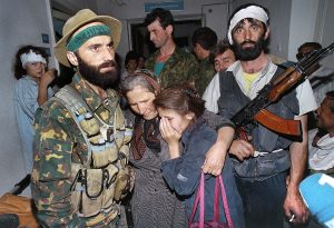 Bearded leader of Chechen separatists Shamil Basayev (L) standing among hostages in the hospital of Budennovsk where he holds with some 70 other rebels around one thousand of hostages. The hostage-taking which killed nearly 150 people forced Moscow to start talks in the first conflict in Chechnya, which took place from 1994 to 1996. Russian troops entered Chechnya 11 December 1994 with the stated aim of introducing constitutional rule in the Caucasus republic.