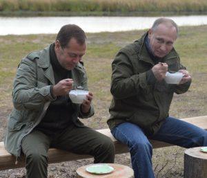 NOVGOROD REGION, RUSSIA - SEPTEMBER 10, 2016: Russia's Prime Minister Dmitry Medvedev (L) and Russia's President Vladimir Putin at Lake Ilmen. Alexei Druzhinin/Russian Presidential Press and Information Office/TASS Ðîññèÿ. Íîâãîðîäñêàÿ îáëàñòü. 10 ñåíòÿáðÿ 2016. Ïðåìüåð-ìèíèñòð ÐÔ Äìèòðèé Ìåäâåäåâ è ïðåçèäåíò ÐÔ Âëàäèìèð Ïóòèí (ñëåâà íàïðàâî) âî âðåìÿ îòäûõà íà áåðåãó îçåðà Èëüìåíü. Àëåêñåé Äðóæèíèí/ïðåññ-ñëóæáà ïðåçèäåíòà ÐÔ/ÒÀÑÑ